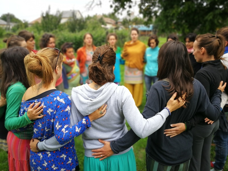 circle of women supporting each other